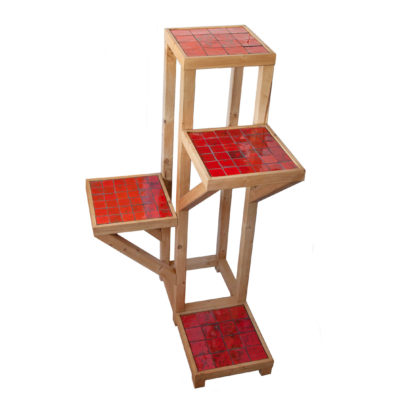 Sculpture-like furniture unit with four shelves, made of wood and red handmade ceramic tiles.