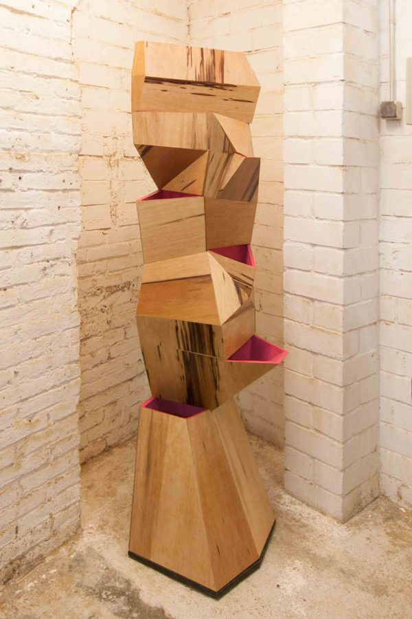 7bocas faceted wooden sculpture with magenta interior
