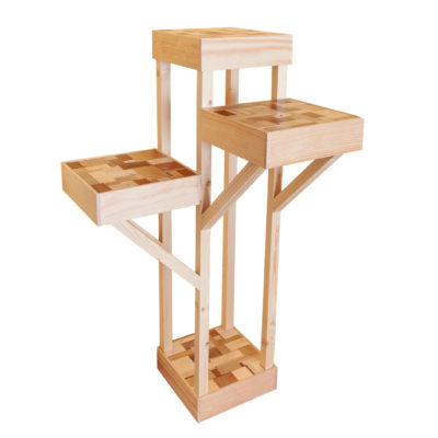Sculpture-like furniture unit with four shelves, made of mixed pieces of wood