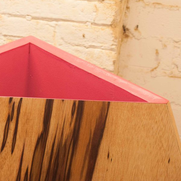 One of the magenta mouths of 7bocas faceted wooden sculpture
