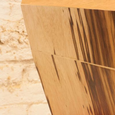 Close up of 7bocas faceted wooden sculpture joint