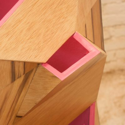 One of the magenta mouths of 7bocas faceted wooden sculpture with magenta interior