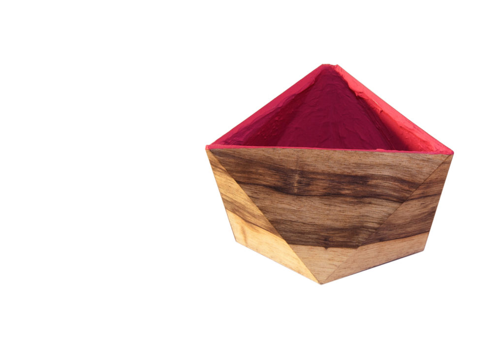 Faceted plant pot veneered with wood outside and magenta inside
